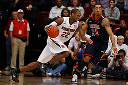 February 3, 2011; Stanford, CA, USA;  Stanford Cardinal guard Jarrett Mann (22) is defended by Arizona Wildcats guard Brendon Lavender (24) during the second half at Maples Pavilion.  Arizona defeated Stanford 78-69.