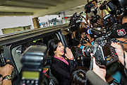 "09 JANUARY 2105 - BANGKOK, THAILAND: YINGLUCK SHINAWATRA, former Prime Minister of Thailand, says goodbye to supporters and gets in a waiting car after presenting her defense during her impeachment at the National Legislative Assembly. Thailand's military-appointed National Legislative Assembly began impeachment hearings Friday against former Prime Minister Yingluck Shinawatra. If she is convicted, she could be forced to stay out of politics for five years. During her defense, Yingluck questioned the necessity of her impeachment, saying, ""I was removed from office, the equivalent of being impeached, three times already, I have no position left to be impeached from."" A decision on her impeachment is expected by the end of January.    PHOTO BY JACK KURTZ"