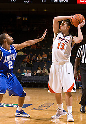 Virginia guard Sammy Zeglinski (13) is guarded by Hampton guard Vincent Simpson (2).  The Virginia Cavaliers defeated the Hampton Pirates 74-48 at the John Paul Jones Arena on the Grounds of the University of Virginia in Charlottesville, VA on December 23, 2008. (Special to the Daily Progress / Jason O. Watson)