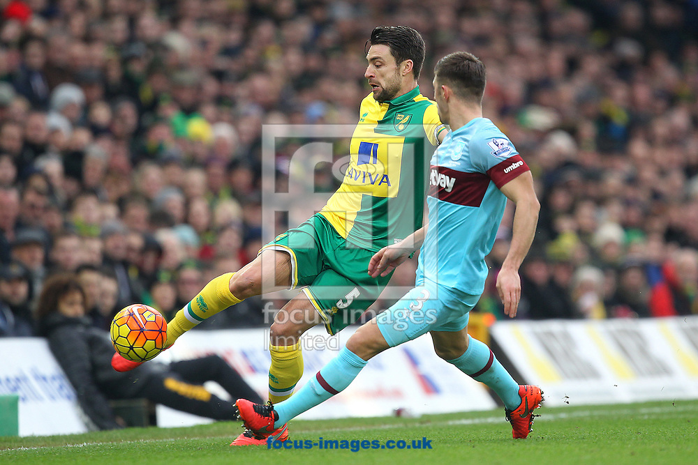 Russell Martin of Norwich and Aaron Cresswell of West Ham in action during the Barclays Premier League match at Carrow Road, Norwich<br /> Picture by Paul Chesterton/Focus Images Ltd +44 7904 640267<br /> 13/02/2016