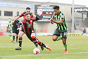 Lyle Taylor of AFC Wimbledon takes on Shaun Beeley of Morecambe FC during the Sky Bet League 2 match between Morecambe and AFC Wimbledon at the Globe Arena, Morecambe, England on 12 March 2016. Photo by Stuart Butcher.