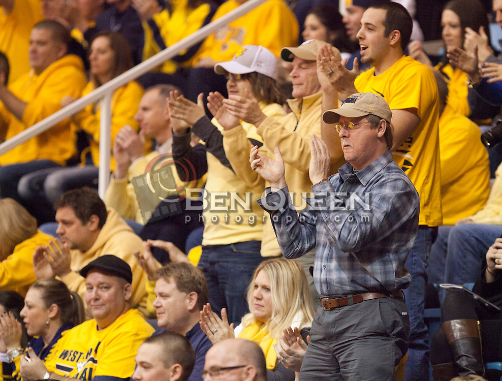 West Virginia fans cheer during the first half at the WVU Coliseum.
