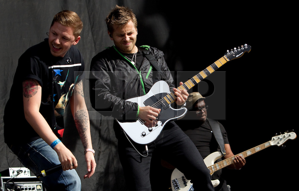 © licensed to London News Pictures . 30/06/2012 . Manchester , UK . Professor Green ( Stephen Manderson ) performs on stage at Heaton Park as warm up for the Stone Roses , who are on their comeback tour . Photo credit : Joel Goodman/LNP