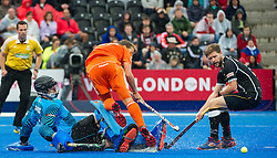 The Netherlands Constantijn Jonker is stopped by Nicolas Jacobi of Germany. The Netherlands v Germany - Final Unibet EuroHockey Championships, Lee Valley Hockey & Tennis Centre, London, UK on 29 August 2015. Photo: Simon Parker