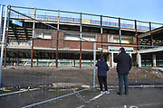 Plymouth Argyle fans outside Home Park Stadium looking through the safety fence at the Mayflower stand which is being rebuilt before the EFL Sky Bet League 1 match between Plymouth Argyle and Accrington Stanley at Home Park, Plymouth, England on 22 December 2018.