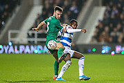 Sheffield Wednesday defender Morgan Fox (3) tussles with Queens Park Rangers midfielder Bright Osayi-Samuel (20) during the The FA Cup match between Queens Park Rangers and Sheffield Wednesday at the Kiyan Prince Foundation Stadium, London, England on 24 January 2020.