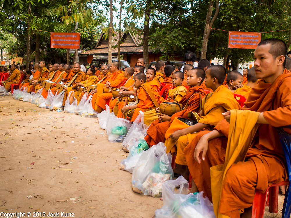 15 MARCH 2015 - SIEM REAP, SIEM REAP, CAMBODIA: Buddhist monks and novices at the annual mass merit making at Wat Bo in Siem Reap. More than 1,200 Buddhist monks, from across Siem Reap province, received alms from Buddhist lay people during the morning long ceremony. Wat Bo was originally built to be a the temple for Siamese (Thai) troops when Siem Reap and western Cambodia were controlled by Siam (Thailand). Now Wat Bo is one of the most important temples in Siem Reap.      PHOTO BY JACK KURTZ