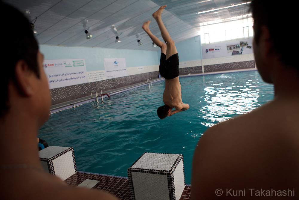 (Kabul, Afghanistan - May 16, 2012).A man shows off acrobatic diving at the brand-new indoor swimming pool in Kabul, Afghanistan on May 16, 2012. The largest indoor swimming facility in the country has Jacuzzi, steam bath and a cafeteria as well as swimming training programs. .(Photo by Kuni Takahashi)