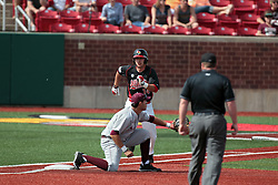 26 April 2014:  Umpire Grady Smith watches as first baseman Ryan Casillas gets the throw ahead of Paul DeJong during an NCAA Division 1 Missouri Valley Conference (MVC) Baseball game between the Southern Illinois Salukis and the Illinois State Redbirds in Duffy Bass Field, Normal IL