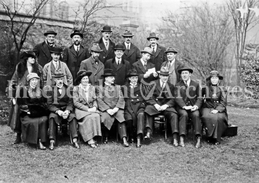 Senior members of Sinn Féin, possibly at the party's October 1919 Ard Fheis. Due to the British suppression of Sinn Féin this was the last Ard Fheis held until 1921. From left to right in the front row, seated: Hanna Sheehy-Skeffington, Harry Boland, Unknown, Unknown, Eamon De Valera, Michael Collins, Arthur Griffith, Unknown. (Part of the Independent Newspapers Ireland/NLI Collection)