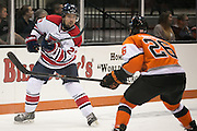 RIT's Caleb Cameron puts pressure on Brock University's Tyler Anton during a game at the Gene Polisseni Center on Saturday, October 4, 2014.