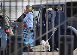 **NOTE TO EDITORS: Image has been pixelated to hide the identity of a juvenile**<br /> © Licensed to London News Pictures. 14/09/2020. London, UK. Carrie Symonds holds her and Prime Minister Boris Johnson's baby son Wilfred as she arrives at Downing Street with Prime Minister Johnson (Not Pictured). It has been reported that a baptism for son Wilfred was held over the weekend. Photo credit: Peter Macdiarmid/LNP