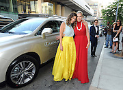 Designer Irene Neuwirth, left, and actress Busy Philipps arrive in a Lexus to the CFDA 2014 Fashion Awards, Monday June 2, 2014 in New York. (Photo by Diane Bondareff/Invision for Lexus/AP Images)