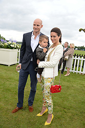 GUNNAR and SASKIA WINBERGH and her son RIVER at the 2013 Cartier Queens Cup Polo at Guards Polo Club, Berkshire on 16th June 2013.