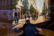 Modern-day Metro Bank offices with the backdrop of a vintage street scene, plus contemporary traffic in reflected city.