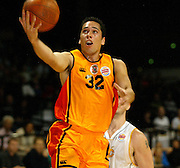 Hawk number 32 Paul Henare in action during the NBL basketball match between the Wellington Saints and the Mighty Hawks, 14 April, 2002 at the Wellington Event Centre. Photo: PHOTOSPORT<br /><br /><br /><br />046435 *** Local Caption ***