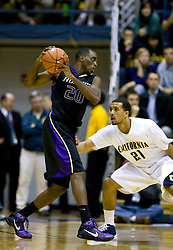 February 11, 2010; Berkeley, CA, USA;  Washington Huskies forward Quincy Pondexter (20) is guarded by California Golden Bears forward Omondi Amoke (21) during the second half at the Haas Pavilion.  California defeated Washington 93-81.