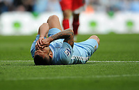 Football - Premier League - Manchester City vs. Queens Park Rangers<br /> Manchester City's Carlos Tevez lies on the floor following a foul by Joey Barton of Queens Park Rangers for which he received a straight red card at the Etihad Stadium, Manchester