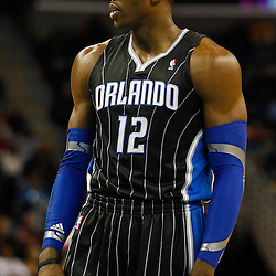 January 12, 2011; New Orleans, LA, USA; Orlando Magic center Dwight Howard (12) against the New Orleans Hornets during the second half at the New Orleans Arena. The Hornets defeated the Magic 92-89.  Mandatory Credit: Derick E. Hingle