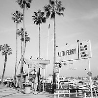 Newport Beach Balboa Island Ferry entrance photo with the Auto Ferry sign and U-Drive boat sign. Located in Newport Beach California, The Balboa Island Ferry has been operating since 1919 and carries people and cars from Balboa Peninsula to Balboa Island across Newport Harbor (Newport Bay). Image Copyright © 2010 Paul Velgos with All Rights Reserved.