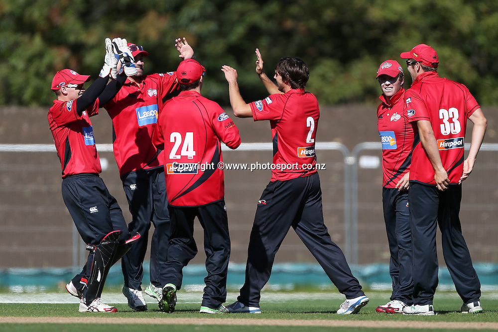 Ryan McCone of the Wizards celebrates a wicket with team mates during the Ford Trophy cricket match between the Canterbury Wizards v Northern Knights at Hagley Oval, Christchurch. 26 March 2014 Photo: Joseph Johnson/www.photosport.co.nz