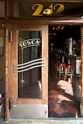 San Francisco, California, July 20, 2008-The open doorway to Tosca Cafe. For almost 80 years this bar has remained untouched. Two large, antique espresso machines, a long bar, original red vinyl booths, and a vintage jukebox with the original records all lie within the historic deco structure.