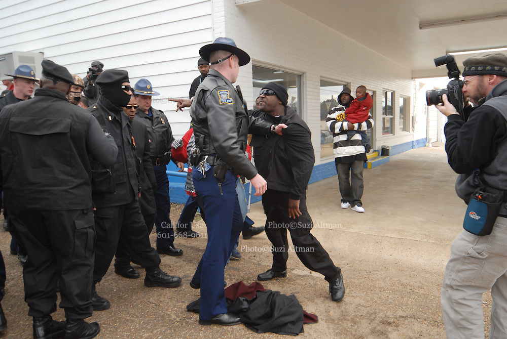 A group of protesters march to Jena High School on the Martin Luther King Jr. holiday in Jena, La., Monday, Jan. 21, 2008. The protest was organized by the self-described 'pro-majority' Nationalist Movement of Learned, Mississippi, lead by Richard Barrett, and was being held in opposition to the six black teenagers who were arrested in the beating of a white classmate in December 2006, and the King holiday. The protest drew about 50 participants and 100 counter-demonstrators to Jena.(Photo/© Suzi Altman)