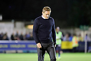 AFC Wimbledon manager Neal Ardley walking off pitch looking at ground during the EFL Sky Bet League 1 match between AFC Wimbledon and Milton Keynes Dons at the Cherry Red Records Stadium, Kingston, England on 22 September 2017. Photo by Matthew Redman.
