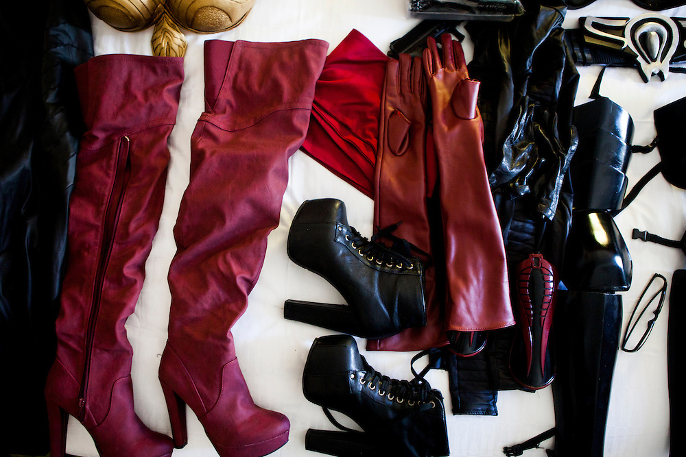 Cosplayer Yaya Han's various costumes are laid out on the bed of her hotel room.