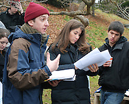"December 5, 2009- Director, senior Michael Bonner (left), rehearses lines with the actors, including Paige Stark, while lighting assistant Max Gosselin-Ildari watches on, before recording any takes on the set of ""The Last Laugh"" at Mount Auburn Cemetery in Cambridge, MA."
