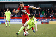 Crawley Town Defender Jon Ashton (16) concedes a freekick against Hartlepool United midfielder Nathan Thomas (7)during the Sky Bet League 2 match between Crawley Town and Hartlepool United at the Checkatrade.com Stadium, Crawley, England on 19 March 2016. Photo by Andy Walter.