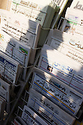 The shadow of a passing pedestrian is cast over Arabic newspapers headlines on sale in a London shop.
