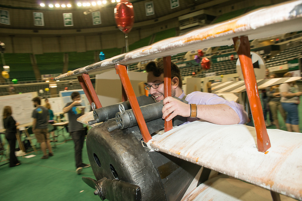 Ohio University student Ricky Lurie takes a prop on display at the Student Expo for a joyride on the floor of the Convocation Center on Thursday, April11, 2013. Photo by Ben Siegel