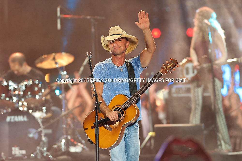 NASHVILLE, TN - JUNE 10: Kenny Chesney performs onstage during the 2015 CMT Music Awards at Bridgestone Arena on June 10, 2015 in Nashville, Tennessee. (Photo by Erika Goldring/Getty Images for CMT)