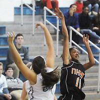 New Hanover's Amani Muhammad shots over Hoggard's Aleah Thompson Friday December 12, 2014 at Hoggard High School in Wilmington, N.C. (Jason A. Frizzelle)