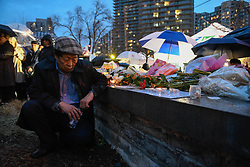 John Cho pays his respects at a vigil on Yonge Street in Toronto, Tuesday, April 24, 2018. Ten people were killed and 14 were injured in Monday's deadly attack in which a van struck pedestrians in northern Toronto, ON, Canada. Photo by Galit Rodan/CP/ABACAPRESS.COM