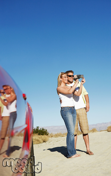 Couple Taking Photographs