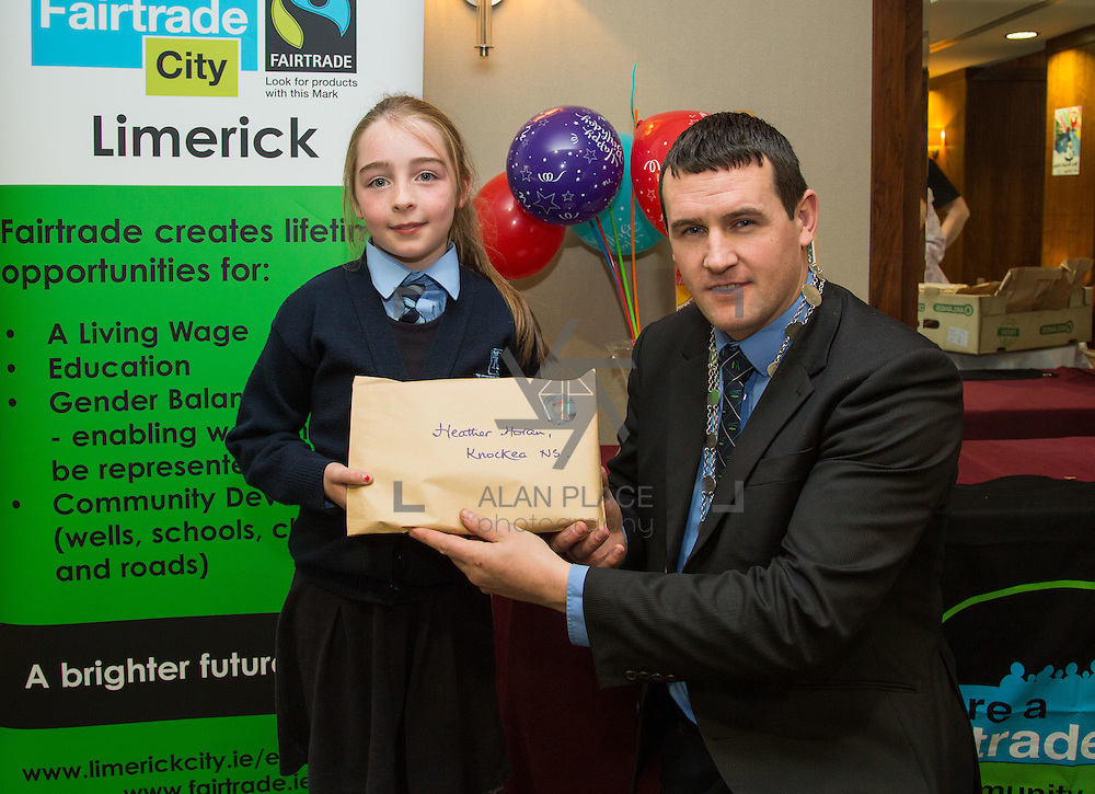 22.11.2016                   <br /> Christmas has come early for two Limerick students after they were named overall winners of the 2016 Limerick City Fairtrade Christmas Card Competition at a ceremony in The Savoy Hotel.<br /> <br /> Receiving their prize from Deputy Mayor Cllr. Frankie Daly was Heather Horan, Knockea N.S.. Picture: Alan Place