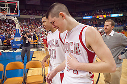 Poca players react after winning the Class AA championship game at the Charleston Civic Center.