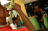 Locals enjoy cold beers at a store in Orika, the small local village on Isla Grande, one of the islands in an archipelago known as Islas del Rosario, about 35km southwest of Cartagena, on Colombia's Caribbean coast on January 2, 2009. (Photo/Scott Dalton)