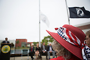 Peggy Horyza wears an American Flag bandana on her red hat during the Milpitas Memorial Day Ceremony at Veterans Memorial Flag Plaza in Milpitas, California, on May 27, 2013. (Stan Olszewski/SOSKIphoto)