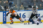 RIT forward Erik Brown and Air Force defenseman Matt Koch collide during the Atlantic Hockey semifinal at the Blue Cross Arena at the War Memorial in Rochester on Friday, March 18, 2016.