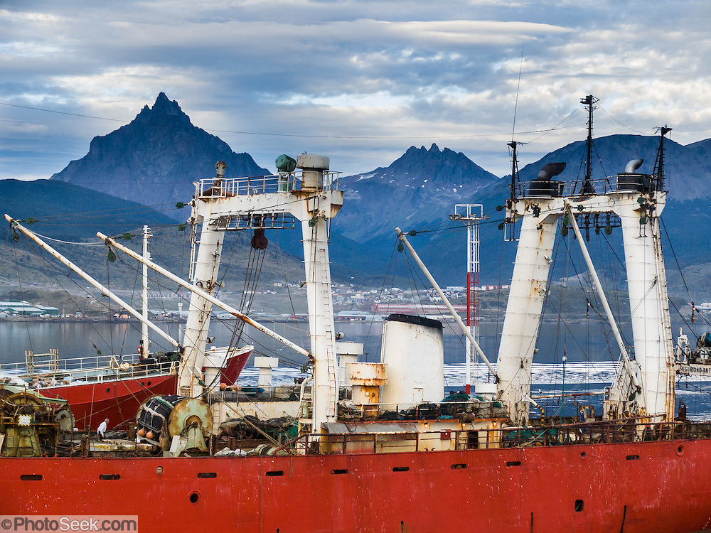 "The Martial Mountains rise above a ship in the Beagle Channel at the Port of Ushuaia, capital city of Tierra del Fuego Province, Argentina, South America. As the port closest to Antarctica (which is located 400 miles across the Drake Passage), Ushuaia hosts most of the cruise ships that visit the southernmost continent. Argentina claims Ushuaia is the ""southernmost city in the world"" (although the smaller Chilean town of Puerto Williams lies further south)."