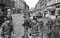 British soldiers seal off Royal Avenue, Belfast, N Ireland, following an explosion outside the former Grand Central Hotel in March 1974. The hotel  became even more of a target after it was taken over by the British Army as as a base and billet. 197403000216a.<br /> <br /> Copyright Image from Victor Patterson, 54 Dorchester Park, Belfast, UK, BT9 6RJ<br /> <br /> t1: +44 28 9066 1296 (from Rep of Ireland 048 9066 1296)<br /> t2: +44 28 9002 2446 (from Rep of Ireland 048 9002 2446)<br /> m: +44 7802 353836<br /> <br /> victorpattersonbelfast@gmail.com<br /> victorpatterson@me.com<br /> <br /> www.victorpatterson.com<br /> <br /> Please see my Terms and Conditions of Use at https://www.victorpatterson.com/page2<br /> It is IMPORTANT that you familiarise yourself with them.<br /> <br /> Images used on the Internet incur an additional cost and must be visibly watermarked i.e. © Victor Patterson within the body of the image and copyright metadata must not be deleted. Images used on the Internet have a size restriction of 4kbs and are chargeable at rates available at victorpatterson.com.<br /> <br /> This image is available only for the use of the download recipient i.e. television station, newspaper, magazine, book publisher, etc, and must not be passed on to any third party. It is also downloaded on condition that each and every usage is notified within 7 days to victorpatterson@me.com<br /> <br /> The right of Victor Patterson (or the named photographer) to be identified as the author is asserted in accordance with The Copyright Designs And Patents Act (1988). All moral rights are asserted.