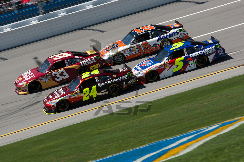 TALLADEGA, AL - APR 17, 2011: Jeff Gordon (24), Mark Martin (5), Clint Bowyer (33), and Michael Waltrip draft during the  at the Talladega Superspeedway in Talladega, AL.
