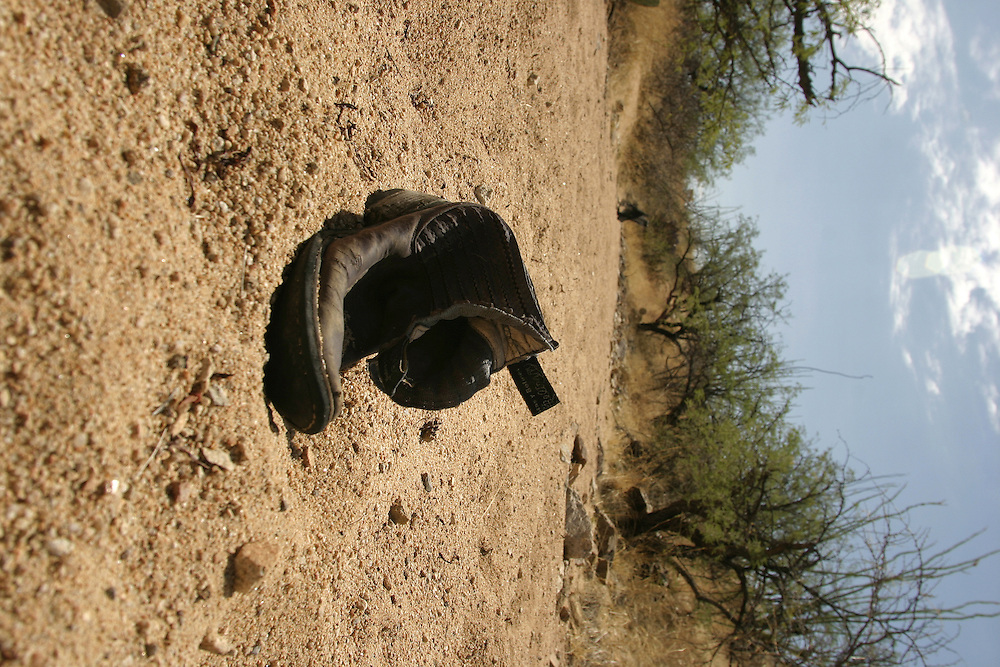 Shoes are left behind in the desert by an undocumented immigrant near the Arizona town of..Arvaka on 13 July 2006.....