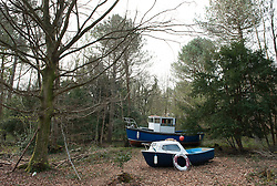 © Licensed to London News Pictures.  17/04/2015. Bristol, UK.  'Withdrawn' by artist Luke Jerram, an installation with fishing boats in Leigh Woods near Bristol, which considers the impact humanity is having on our seas and how our oceans and climate are changing.  Luke Jerram is a multidisciplinary artists who also created the Park and Slide water slide on Bristol's Park Street last year.  Photo credit : Simon Chapman/LNP