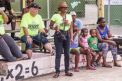Community Action NOW's executive director, Iffat Walker, with volunteers and residents enjoy the Avengerz Band.  First annual Savan Resource Fair & Re-dedication Ceremny at Savan Basketball Court.  25 July 2015.  © Aisha-Zakiya Boyd