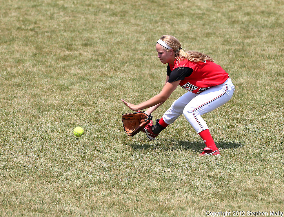 City High outfielder Ruth Grace (19) pulls in a hit during the game between West Liberty and Iowa City High in the 25th Annual Iowa City West Softball Classic at the University of Iowa Softball Complex in Iowa City on Saturday afternoon, June 30, 2012. City High scored five runs in the bottom of the 7th inning to defeat West Liberty 6-5.