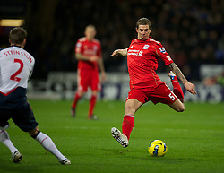 BOLTON, ENGLAND - Saturday, January 21, 2011: Liverpool's Daniel Agger in action against Bolton Wanderers during the Premiership match at the Reebok Stadium. (Pic by David Rawcliffe/Propaganda)